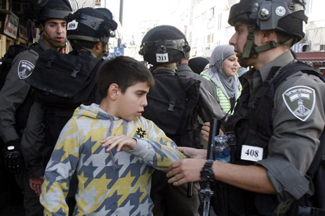 israeli-soldiers-arresting-a-palestinian-boy-child-in-salahaddin-street-for-throwing-stone-at-police-station